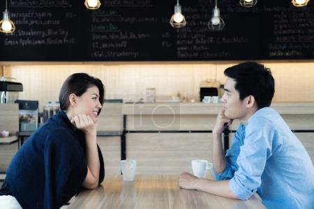 Dating in a cafe. Beautiful Asian lover couple sitting in a cafe