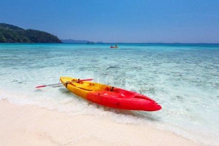 Colorful kayaks on tropical island beach, Thailand