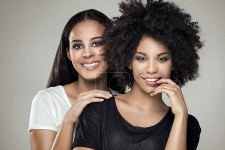 Photo for Beauty photo of two natural young african american girls. One girl with afro hairstyle. - Royalty Free Image