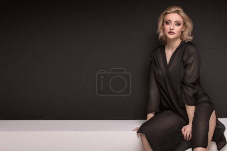 Photo for Sensual delicate blonde lady with glamour makeup posing in elegant style, looking at camera. Studio shot, dark background. Caucasian sexy woman. - Royalty Free Image