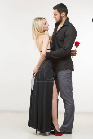 girl holding knife traitor. man with rose in his hand.