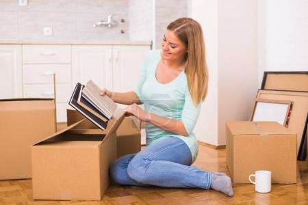 Photo for Beautiful woman moving into new home. - Royalty Free Image