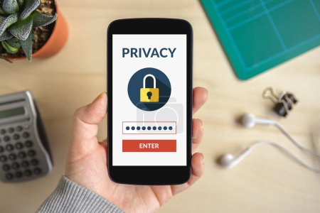 Hand holding smart phone with online privacy conce...