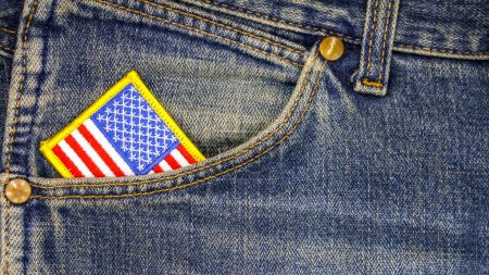 American flag in a pocket of blue old jeans. Happy independence day