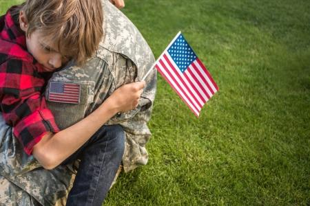 Happy reunion of soldier with family outdoors