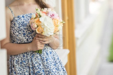Young woman holds flowers