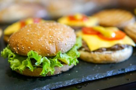 Homemade burger on a wooden table
