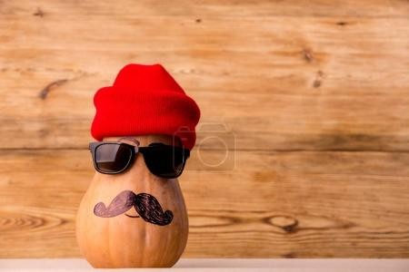 Cute man pumpkin face over rustic background