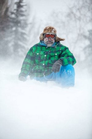 Man traveler hiking in winter in stormy snow weather. Active healthy lifestyle concept