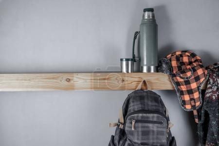 Travel accessories set on wooden shelf and gray background for your text.