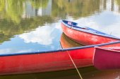 Three blank red canoes