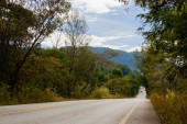 Road through the hills in the Thai Khlong Yai province, Thailand.