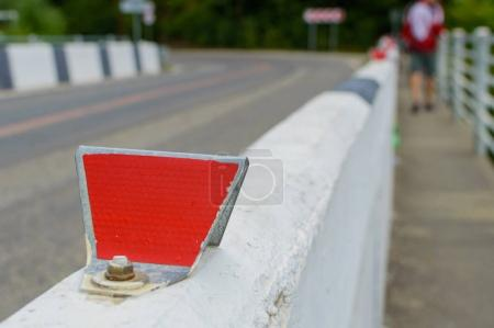 Red reflector on road. Selective focus with shallow depth of field