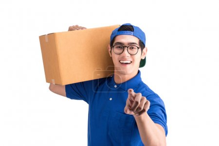 Cheerful delivery man. Happy young courier holding a box