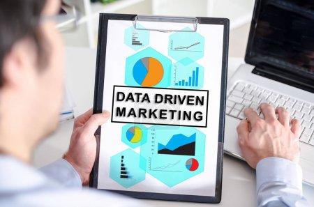 Data driven marketing concept on a clipboard