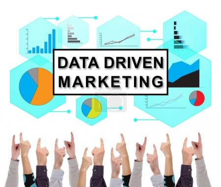 Data driven marketing concept pointed by several fingers