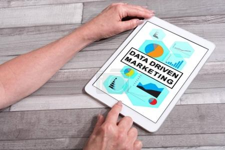 Data driven marketing concept on a tablet