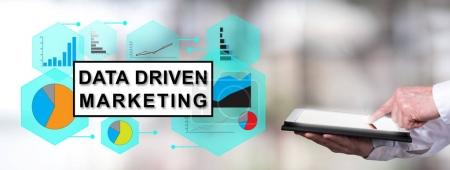 Data driven marketing concept with man using a tablet