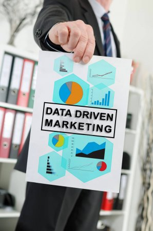 Data driven marketing concept shown by a businessman