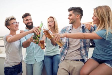 Photo for Friends having party outdoors,drinking beers and having fun. - Royalty Free Image