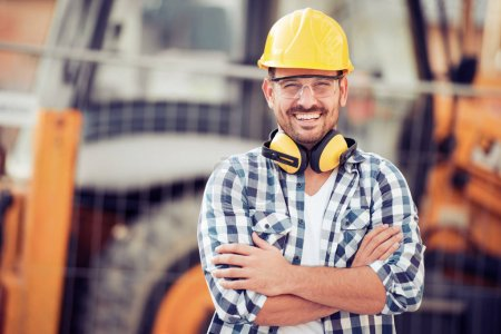 Smiling young businessman construction site engineer