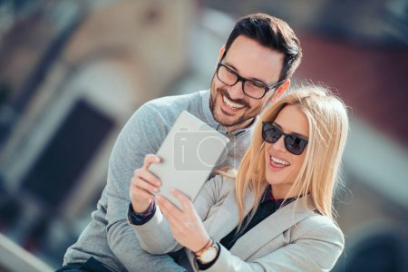 young couple having fun and taking selfie outdoors