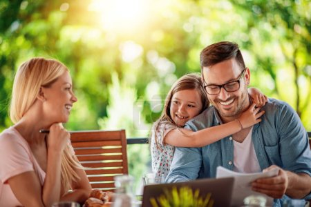 Photo for Happy moments together.Family enjoying on terrace together. - Royalty Free Image
