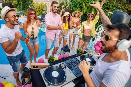 Photo for Dj playing music at  pool party.People,music,happiness and fun concept. - Royalty Free Image
