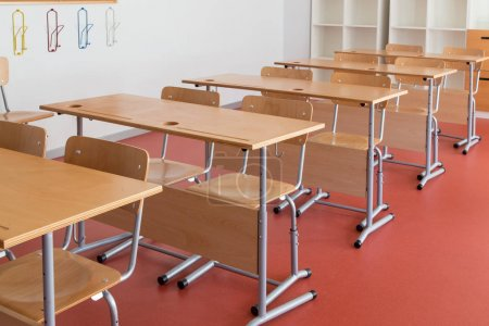 Photo for Empty classroom with wooden desks and chairs - Royalty Free Image