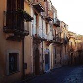 Via Roma. Street of sicilian city Enna. Evening.