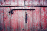 Old red barn doors with rusty bolt. Russian north.