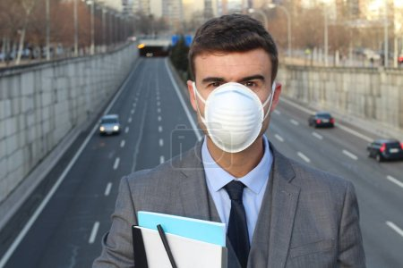 Businessman wearing breathing a mask