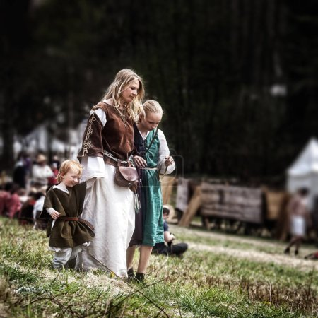 Mother and children medieval Europe. Medieval battle - historica