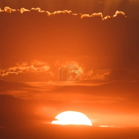 Photo for Sunset behind the clouds, orange sky. beautiful sunset - Royalty Free Image