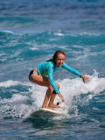 Surfer school. Beautiful young woman in swimsuit. Surfer on the wave