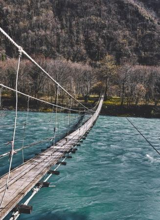 Photo for Suspension bridge. bridge above the river - Royalty Free Image