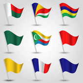 vector set of waving flags east africa on silver pole and blue red yellow and green one - icon of states madagascar mauritius comoros seychelles reunion and mayotte