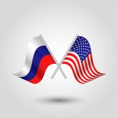 Vector two crossed russian and american flags on silver sticks - symbol of russia and united states of america