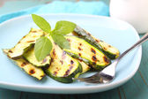 zucchini grilled on blue plate