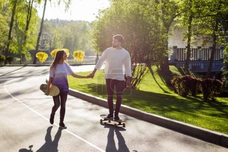 Young skateboarders on road