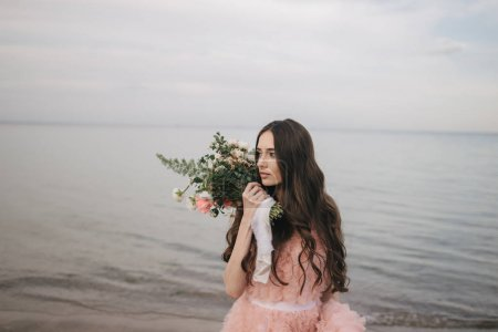 girl with bouquet, alfresco on beach
