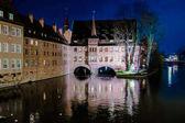 The Heilig-Geist-Spital at night in Nuremberg, Germany.