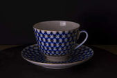 Vintage Russian teacup, isolated black background, Russian style cup, hand made.