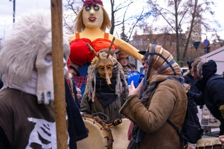 2017-02-25 Lithuania, Vilnius, Shrovetide, Happy people celebration shrovetide, winter go away, straw scarecrow, pancake week, begining spring party.
