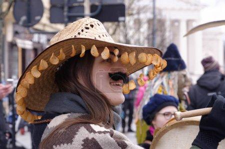 2017-02-25 Lithuania, Vilnius, Shrovetide, happy girl, dressed like a man, carnaval on Vilnius center.