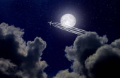 Jet plane and contrail on the background of the full moon