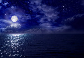 Full moon over the sea and starry sky