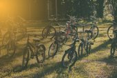 Vintage of  bikes parked on a hill at sunset.