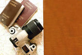Thailand passport and camera on the map for World travel and tra