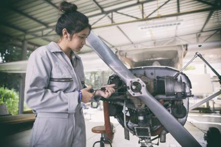 Photo for Asian women Engineers and technicians are repairing aircraft. - Royalty Free Image